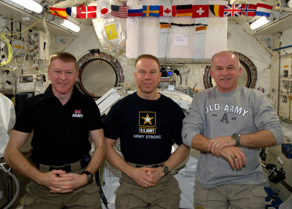 Tim Peake, Tim Kopra and Jeff Williams with Omega Speedmaster